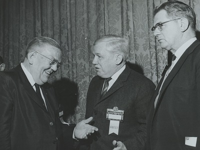 Dr. George W. Taylor (left) chats with the Mayor of Suffern, N.Y. and the Executive Director of the  NYS Conference of Mayors at the Governor's  conference, October 1968.