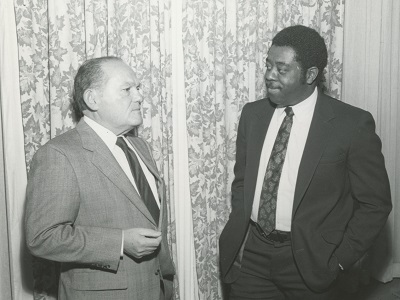 Martin Barr, PERB's Counsel from 1968 until 1989, speaks with an unidentified man.